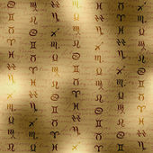 Signs of zodiac on manuscript background