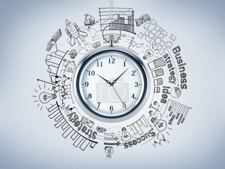 A pocket watch, different graphs and pictures drawn around it, 'business', 'success', 'strategy' written around.
