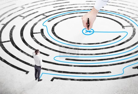 Businessman in front of labyrinth