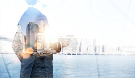 Photo for Businessman and New York water view. Side viiew. Double exposure. Concept of career. - Royalty Free Image
