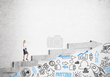 Photo for Businesswoman going up stairs shaped by concrete arrow, business icons under it. Concrete background. Concept of career growth. - Royalty Free Image