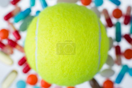 Tennis ball and pills