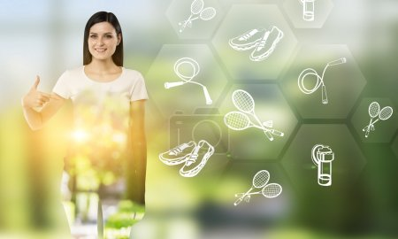 Young woman pointing at hexagonals with outdoor activities icons to the right.