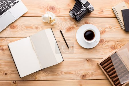 Photo for Wooden table, notebook, vintage camera, cigars and coffee on it. Top view. Concept of work. Mock up. 3D rendering - Royalty Free Image