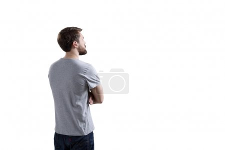 Man looking at white wall