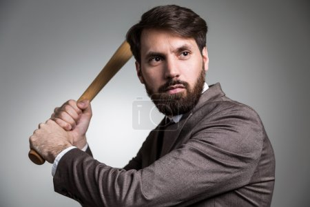 Businessman about to hit bat