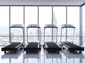 Four treadmills with NY view