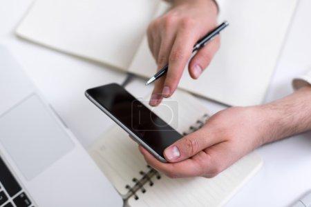 Businessman hands using cellphone