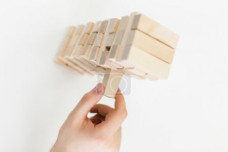 Hand playing with wooden blocks