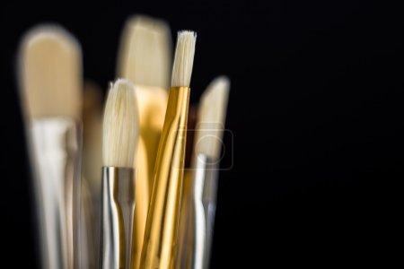 Brushes on black closeup
