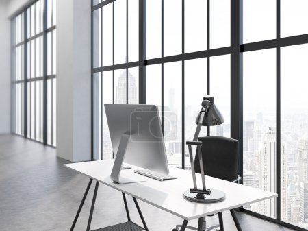 Photo for Side view of office interior with computer monitor and lamp on desk, chair, concrete floor and window with New York city view. 3D Rendering - Royalty Free Image