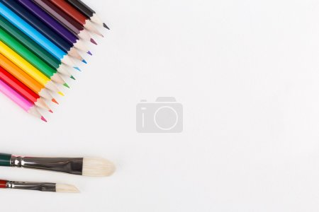 Colorful pencils and paintbrushes