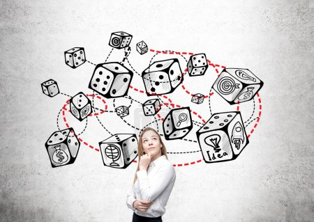 Photo for Thoughtful businesswoman standing against concrete wall with connected dice sketch. Game and probability theory - Royalty Free Image