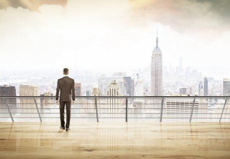 Businessman in suit looking at city