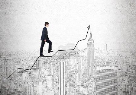 Businessmen climbing graph