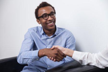 Black man shaking hands