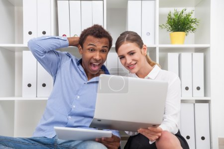 Man and woman watching funny video
