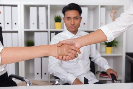 Businessman witnessing handshake