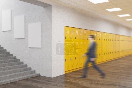 Teacher in school corridor