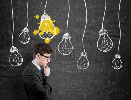 businessman lamp over head
