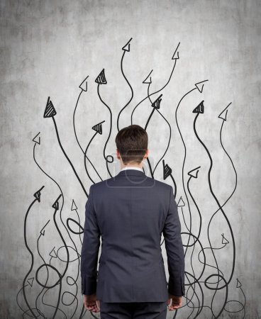 businessman and drawing arrows