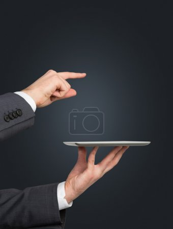 Hand holding touch pad
