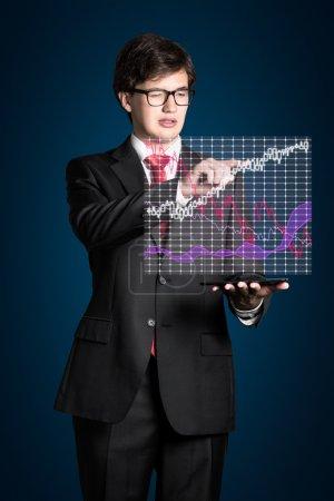 businessman touching chart