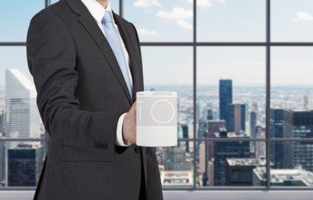 businessman holding mug