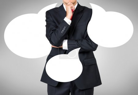 Photo pour Homme d'affaires pense et main tenant parler de bulle - image libre de droit