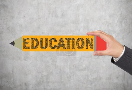 Photo for Hand holding pencil with education text - Royalty Free Image