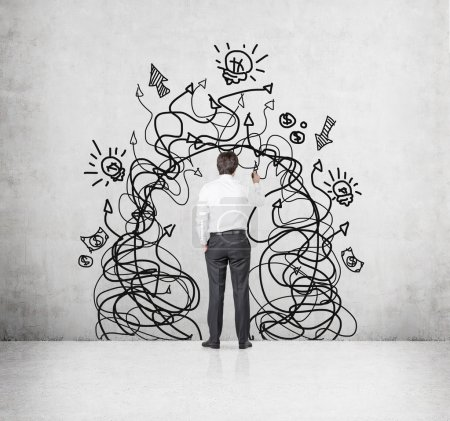 businessman with drawing arrows a