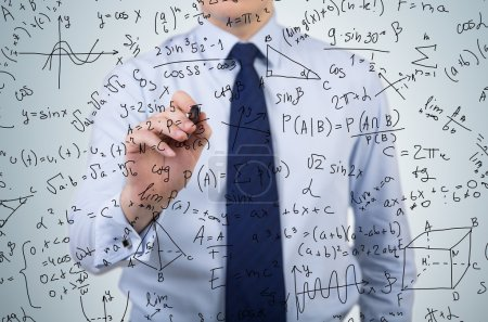 businessman drawing formulas