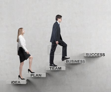 A couple is going up. A concept of the successful business team is making efforts at the career stairs.