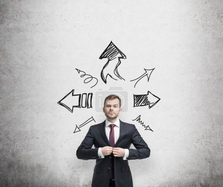 Photo for Businessman is standing surrounded by arrows in different direction. A concept of decision making process. - Royalty Free Image