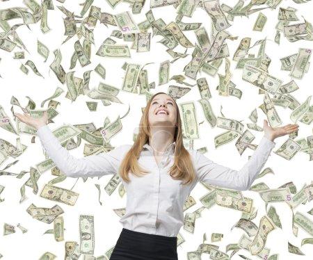 Business woman among  flying dollars