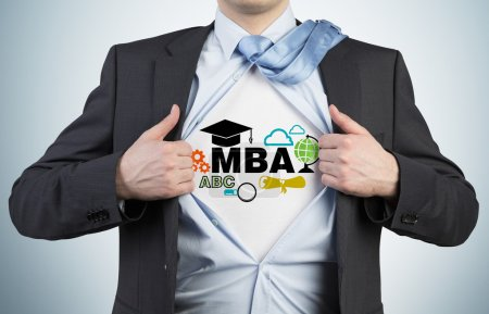 Successful young student is tearing the shirt. Business education icons are drawn on the chest. A concept of the MBA degree.