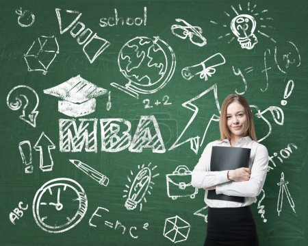 A lady is pondering over the business degree. A concept of the MBA degree. Drawn educational icons on the board.