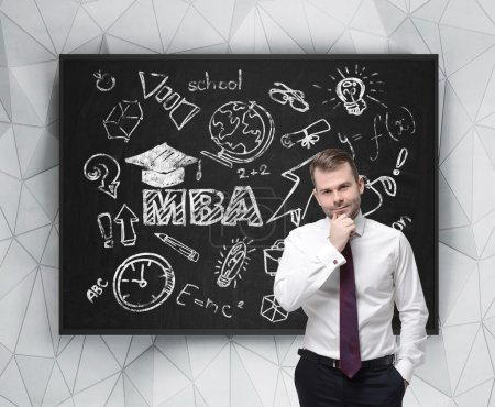 Senior manager is thinking about getting of the business degree. A concept of the MBA degree. Drawn educational icons on the chalkboard.