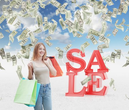 A happy young woman with the colourful shopping bags from the fancy shops. Dollar notes are falling down from the sky as a concept of the sale and discount. Concrete background.