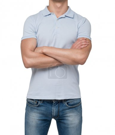 Front view of a person in a blue polo t-shirt with crossed hands. isolated.