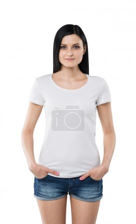 Brunette girl in a white t-shirt and denim shorts. Isolated on white.