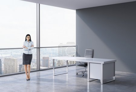 Full-length of a brunette business woman in a workplace at modern panoramic office in New York, Manhattan. A concept of financial consulting services.