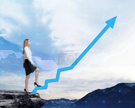 Full length beautiful woman in formal clothes on the rock is going up along the growing arrow. Forex financial chart on the background.