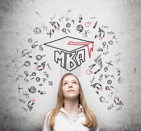 Young lady is thinking about MBA degree. Drawn a graduation hat and the range of educational icons on the concrete background .