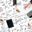 Постер, плакат: A top view of a brainstorm process Colleagues are solving math problems Laptop tablet and math formulas are drawn over the surface on the table