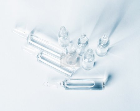 Top view of break-seal glass ampoule set with liqu...