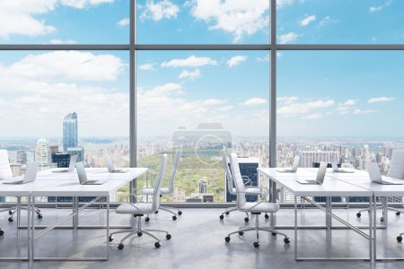 Workplaces in a modern panoramic office, New York city view from the windows. A concept of financial consulting services. 3D rendering.