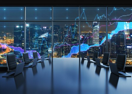 A conference room equipped by modern laptops in a modern panoramic office, evening New York city view. Financial charts are drawn over the panoramic windows. 3D rendering.