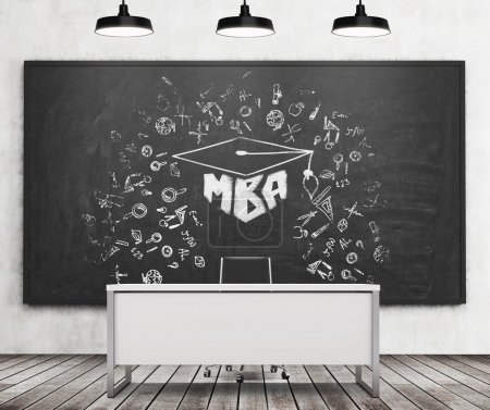 Teacher's or professor's desk in a modern university. A huge black chalkboard on the wall with the MBA sketch. Three black ceiling lights, wooden floor. A concept of business education. 3D rendering.