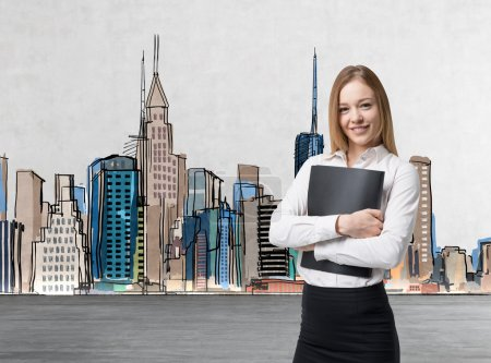 Young beautiful business lady is holding a black document case. A concept of legal services. New York stretch on the background.